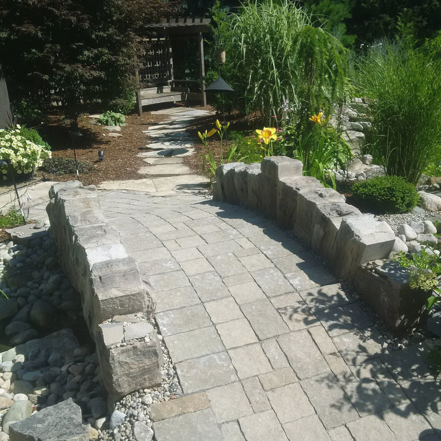 Stone pathway and hand-hewn bridge. A stonework project.